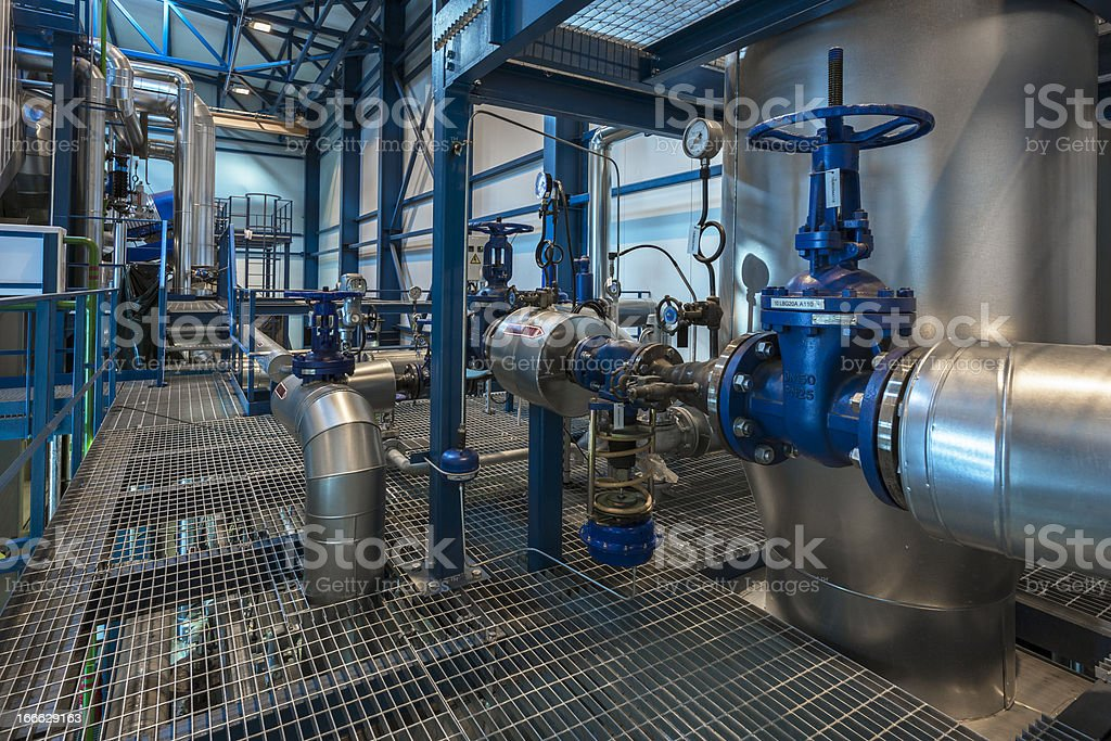 Energy plant pipes and metal platforms shiny and blue stock photo