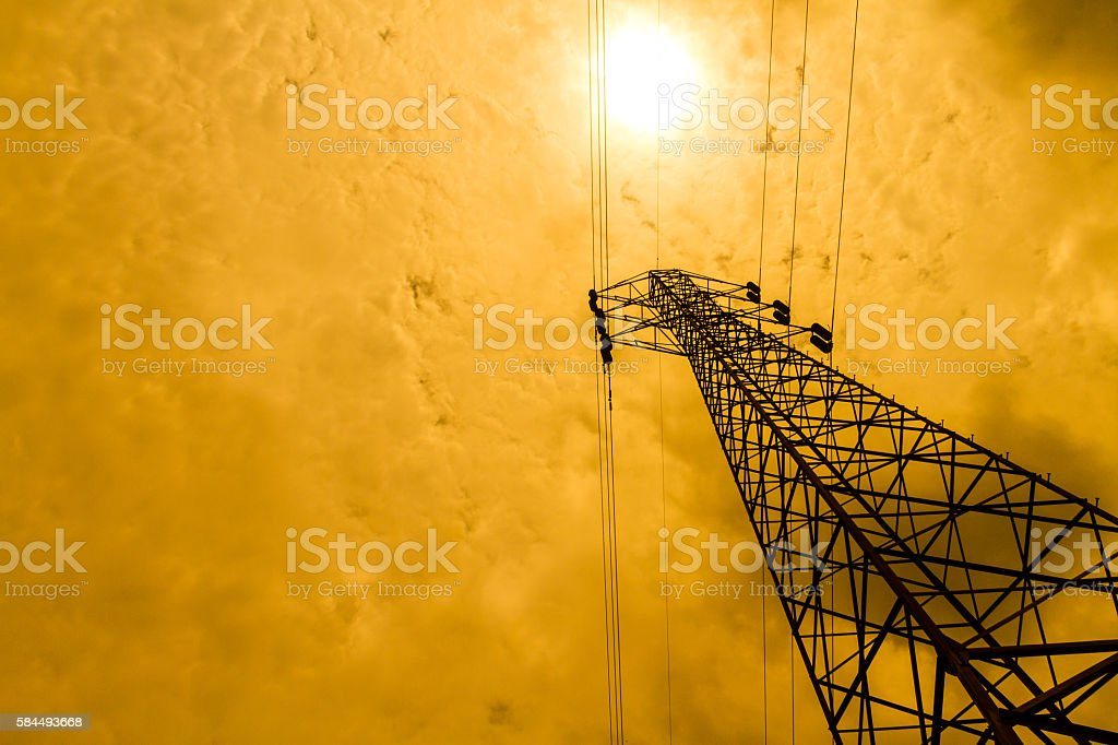 Energy power concept: high voltage pylons with cloud and sun stock photo