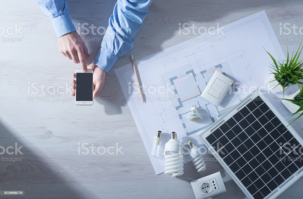 Energy saving and mobile apps stock photo