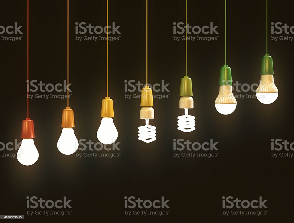 Energy saving bulbs on black background stock photo