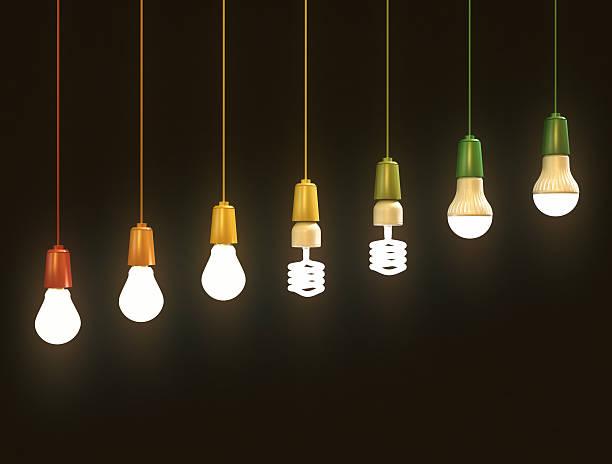 Energy saving bulbs on black background stock photo