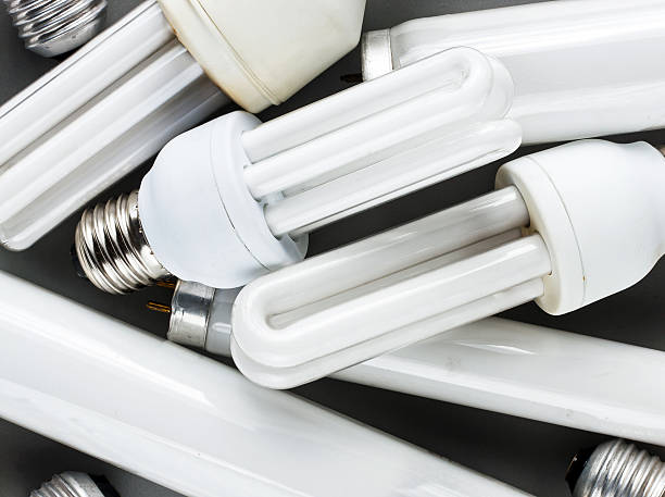 energy saving bulbs - fluorescent light stock pictures, royalty-free photos & images