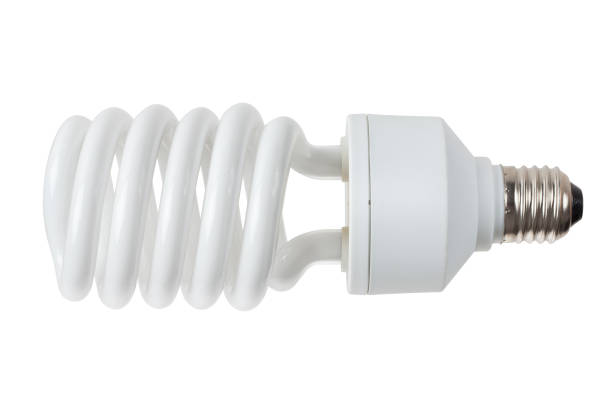energy saving light bulb isolated on white background. clipping path. - fluorescent light stock pictures, royalty-free photos & images
