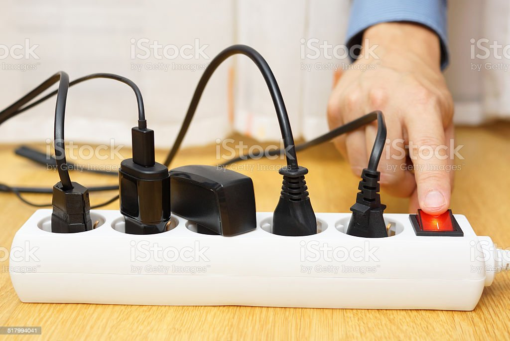 energy savings with turning off electrical appliances stock photo