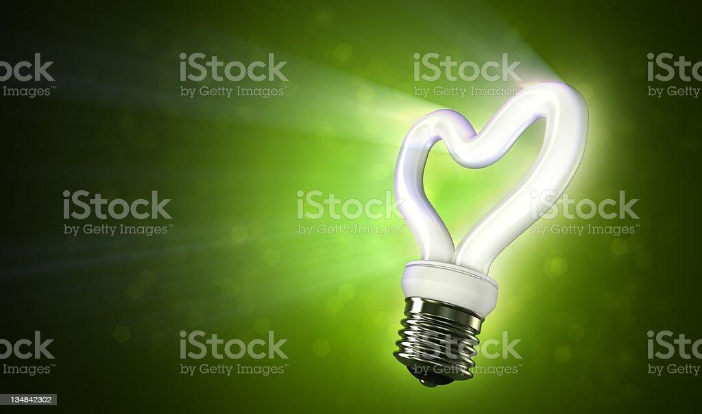 Energy svaing love on green background stock photo