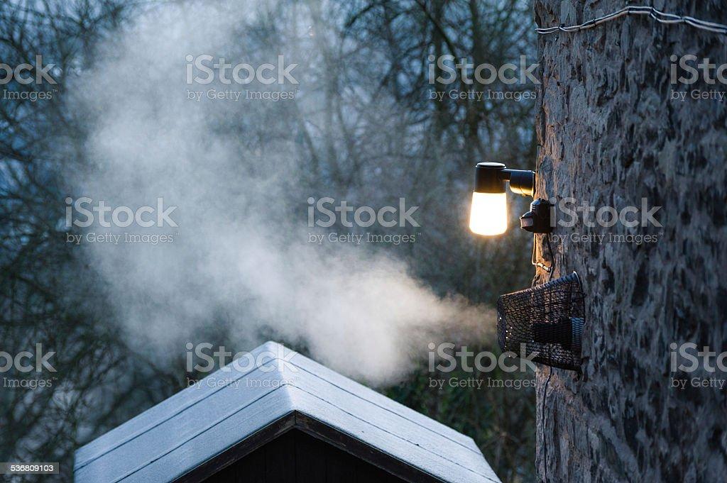 Energy use: condensation smoke from firing gas boiler stock photo