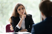 Engaged young recruiter, recruit agent talking to job candidate on interview. Client consulting manager, banker lawyer in office. Business woman, broker, advisor listening to customer on meeting