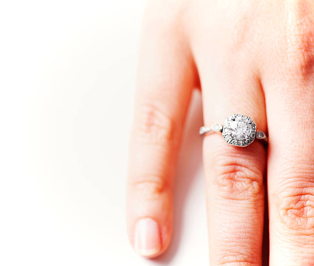 engagement diamond ring - diamond ring hand stock photos and pictures