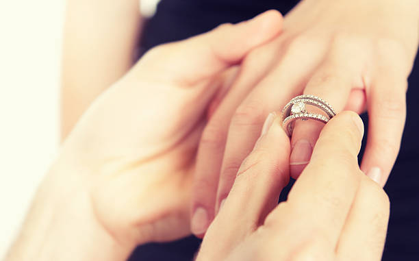 engagement for st. valentine - diamond ring hand stock photos and pictures
