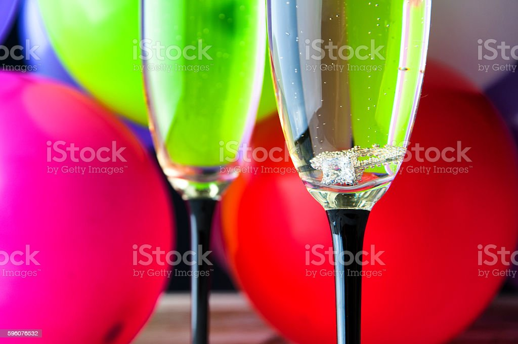 Engagement ring in a glass of champagne royalty-free stock photo