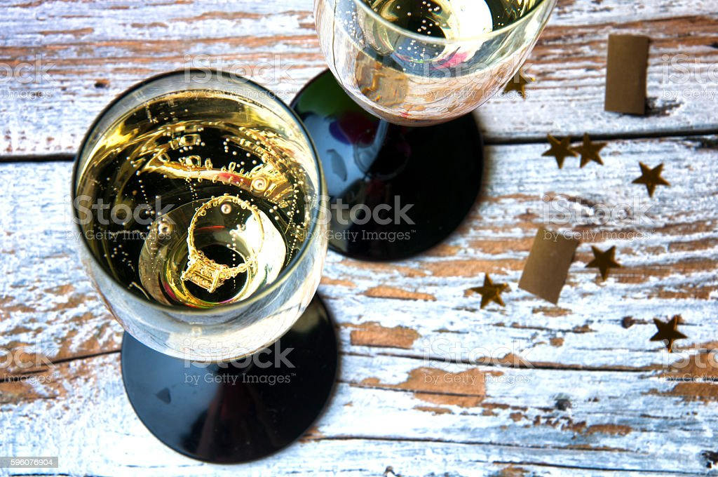 Engagement ring in a glass of champagne. View from above royalty-free stock photo