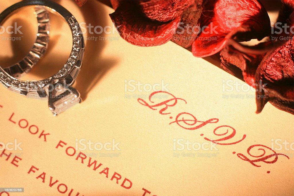 Engagement Ring on Wedding Invitation stock photo