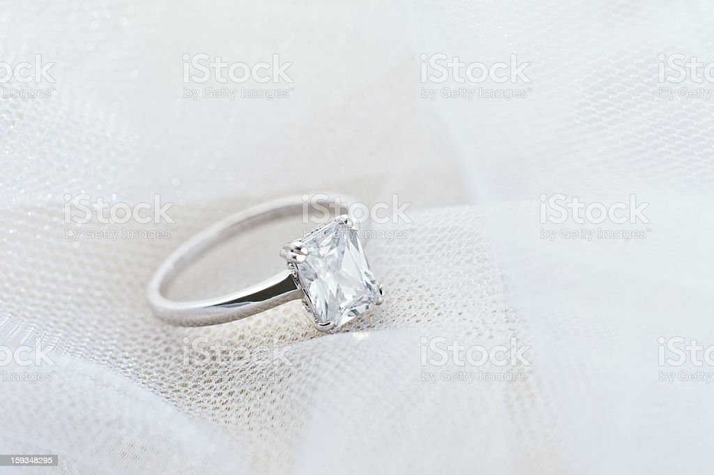 Engagement ring on white veil royalty-free stock photo