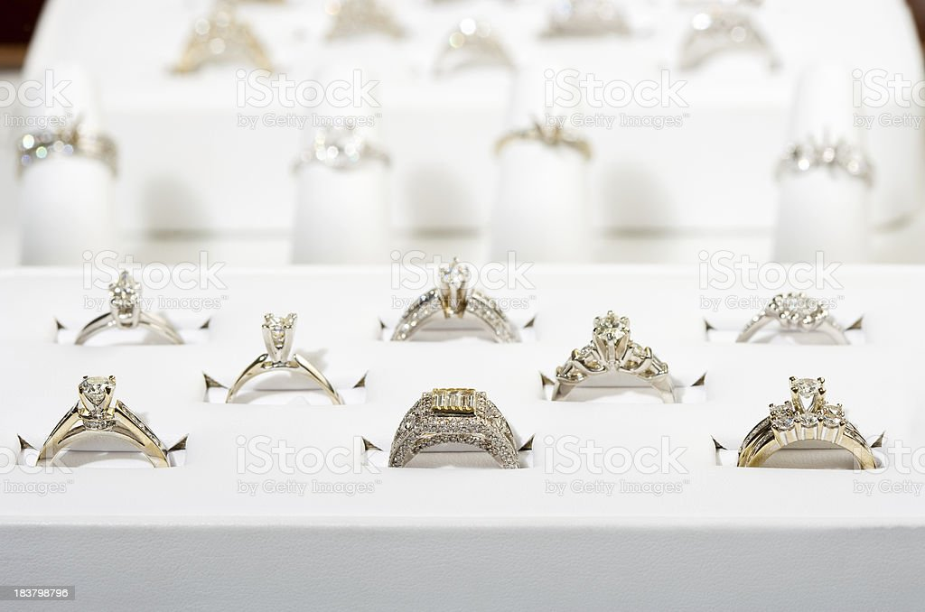 Engagement rings in display case stock photo