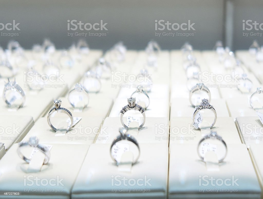 engagement rings in store stock photo