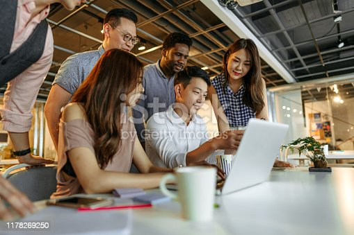 609072850 istock photo Engaging technology as a team 1178269250