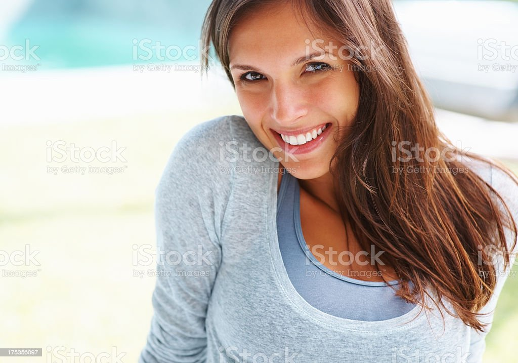 Engaging woman looking at you stock photo