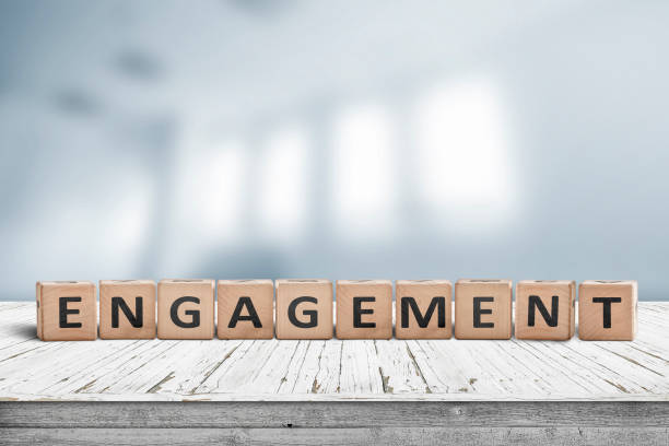 engagment sign made of wooden blocks - employee engagement stock photos and pictures