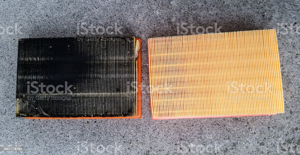 Engine air filter for car, old verses new, side by side stock photo