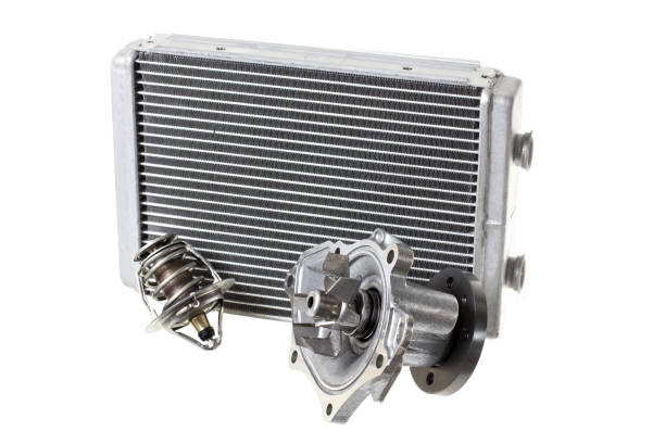 Engine cooling radiators. Water pump and thermostat, two elements of the engine cooling system stock photo