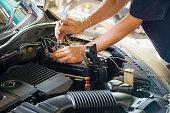 istock Engine engineer is replacing  car battery because car battery is depleted. concept car maintenance And the cost of car care. 1056443532
