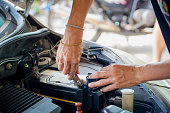 istock Engine engineer is replacing  car battery because car battery is depleted. concept car maintenance And the cost of car care. 1056443928