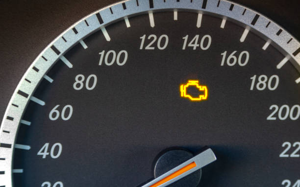 Engine failure symbol lights up in the dashboard of the car stock photo