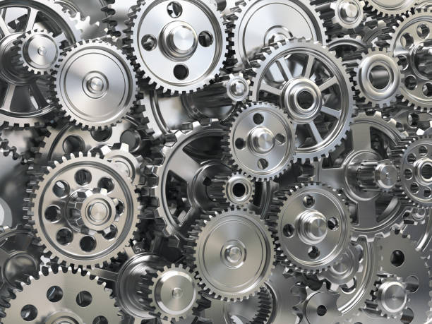 engine gear wheels. industrial and teamwork concept background. - cog stock photos and pictures