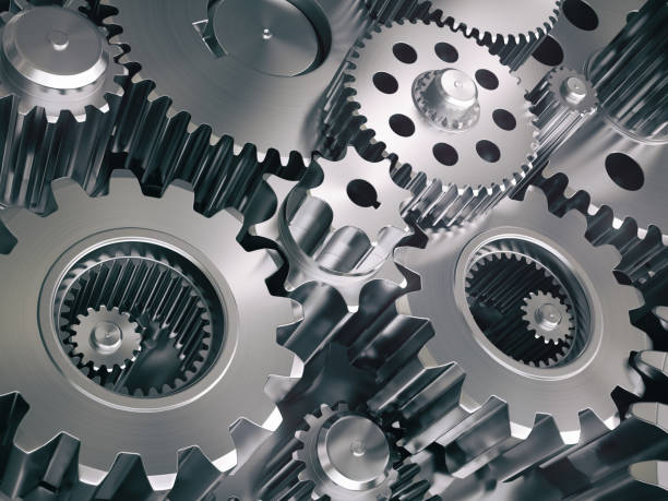 engine gears wheels and cogwheels. industrial background. - cog stock photos and pictures