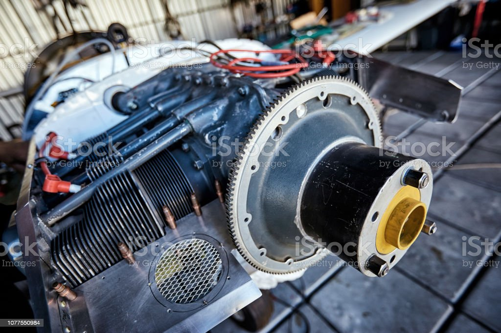 Engine maintenance of a single-engine parkenge aircraft in the hangar. stock photo