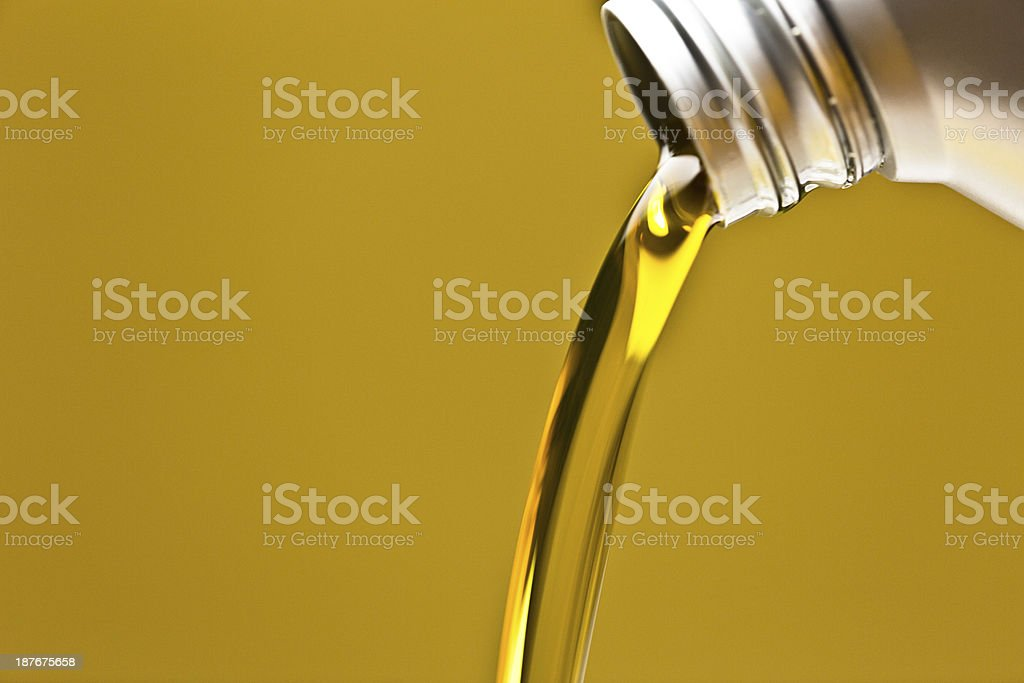 Engine oil being poured out of a bottle stock photo