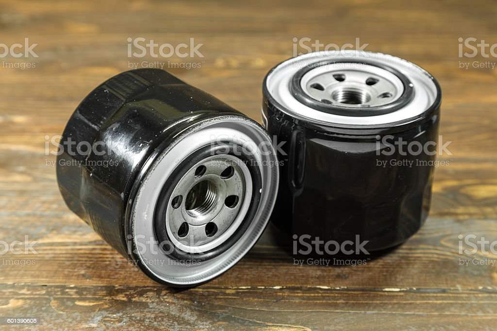 Engine Oil Filter isolated on wooden background. stock photo