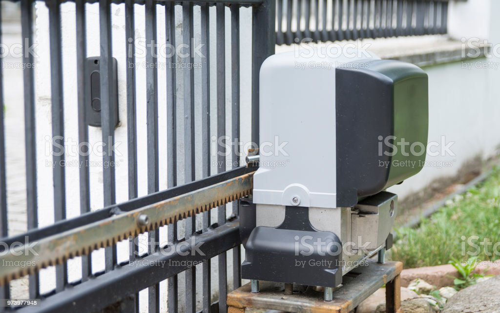 Engine opener for house entrance gate on remote control stock photo
