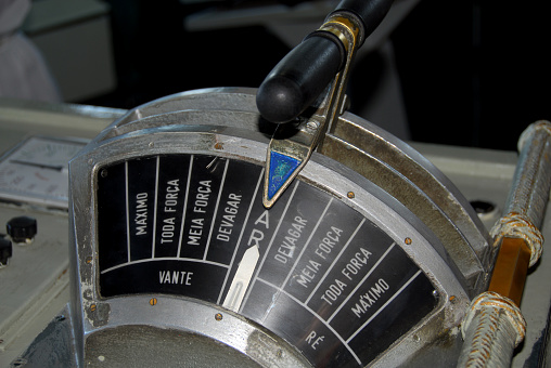 Setubal, Portugal: an engine order telegraph or E.O.T., aka chadburn - communications device used on a ship for the pilot on the bridge to order engineers in the engine room to power the vessel at a certain desired speed - in the stop position, labelled in Portuguese.