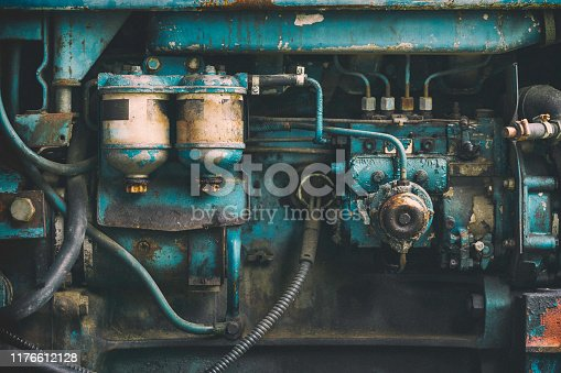 Closeup photo of an old tractor engine.