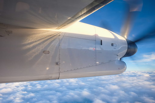 istock Engine propeller aircraft spinning in the sky 813604038