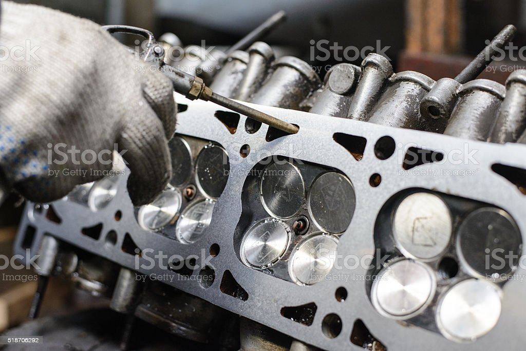 Engine Repair In The Garage Grinding Of The Cylinder Head