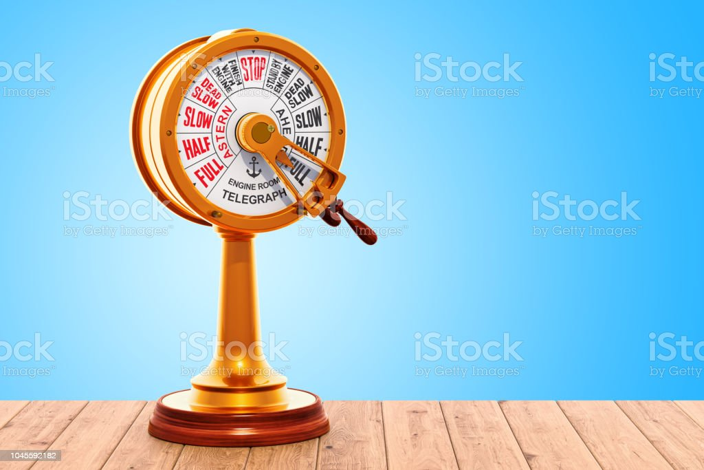 Engine Room Brass Telegraph on the wooden table. 3D rendering stock photo