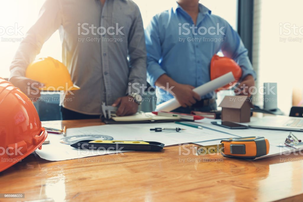 Engineer and Architect concept, Engineer Architects office team working with blueprints Engineer and Architect concept, Engineer Architects office team working with blueprints Adult Stock Photo
