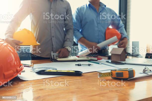 Engineer And Architect Concept Engineer Architects Office Team Working With Blueprints Stock Photo - Download Image Now
