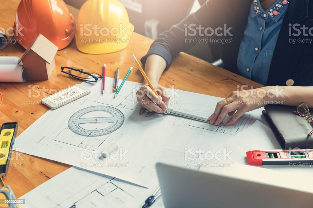 Engineer and Architect concept, Engineer Architects office team working with blueprints - Royalty-free Adult Stock Photo