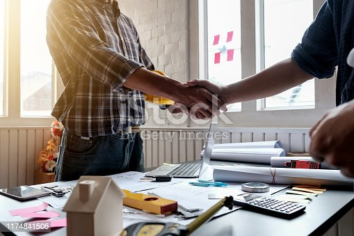 1071990712istockphoto Engineer and architect handshake at meeting with successful construction project. 1174841505