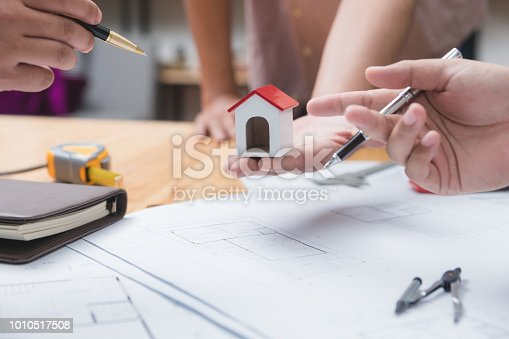 952643774 istock photo Engineer and architect team of real estate agency and company presidents discussing. 1010517508