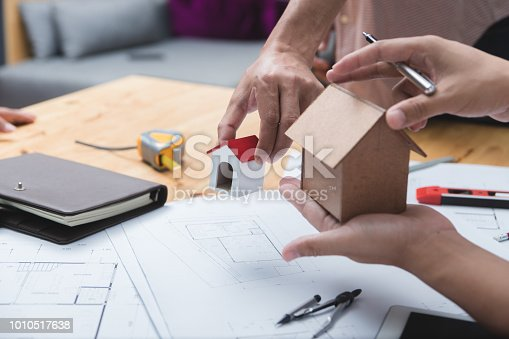 952643774 istock photo Engineer and architect team of real estate agency and company presidents discussing. 1010517638