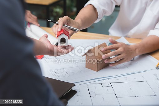952643774 istock photo Engineer and architect team of real estate agency and company presidents discussing. 1010518220