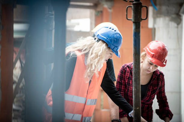 Engineer and architects at construction site