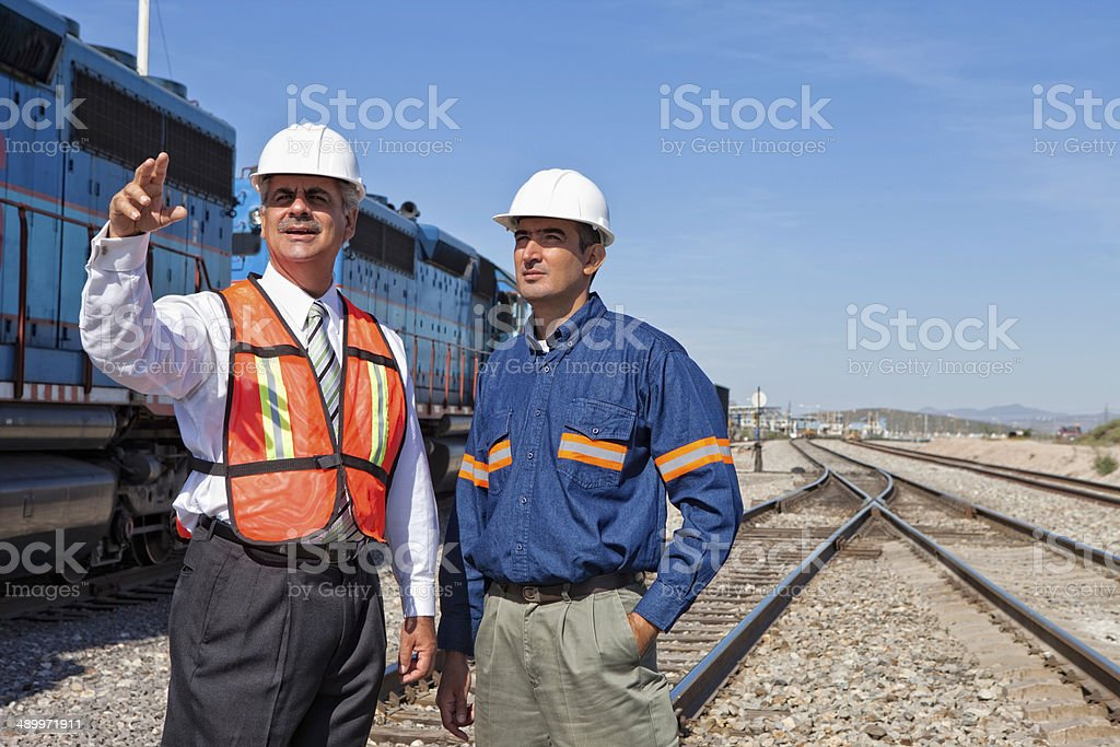 Engineer and Businessman at Railroad Construction stock photo