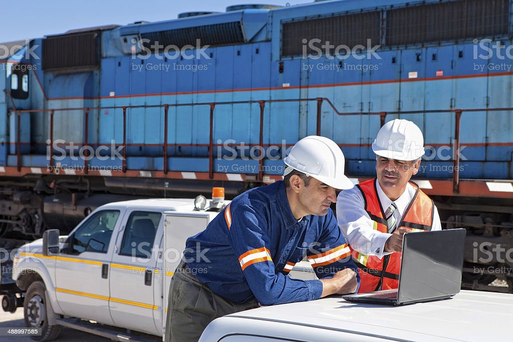 Engineer and Businessman at Railroad Construction Site stock photo
