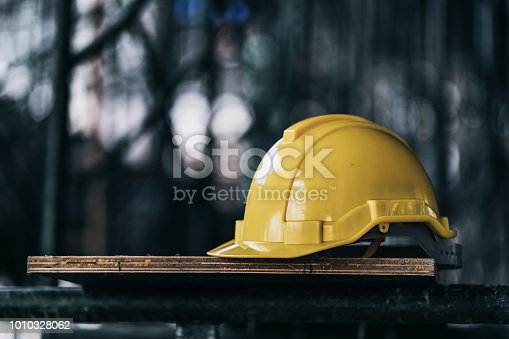 engineer and construction ideas concept with yellow helmet equipment tools at construction site