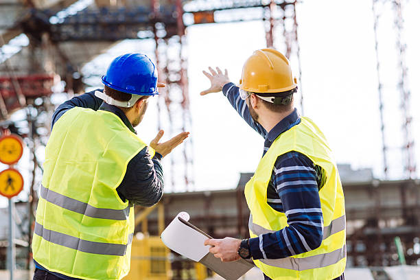 engineer and construction site manager dealing with next construction phase - civil engineering stock pictures, royalty-free photos & images